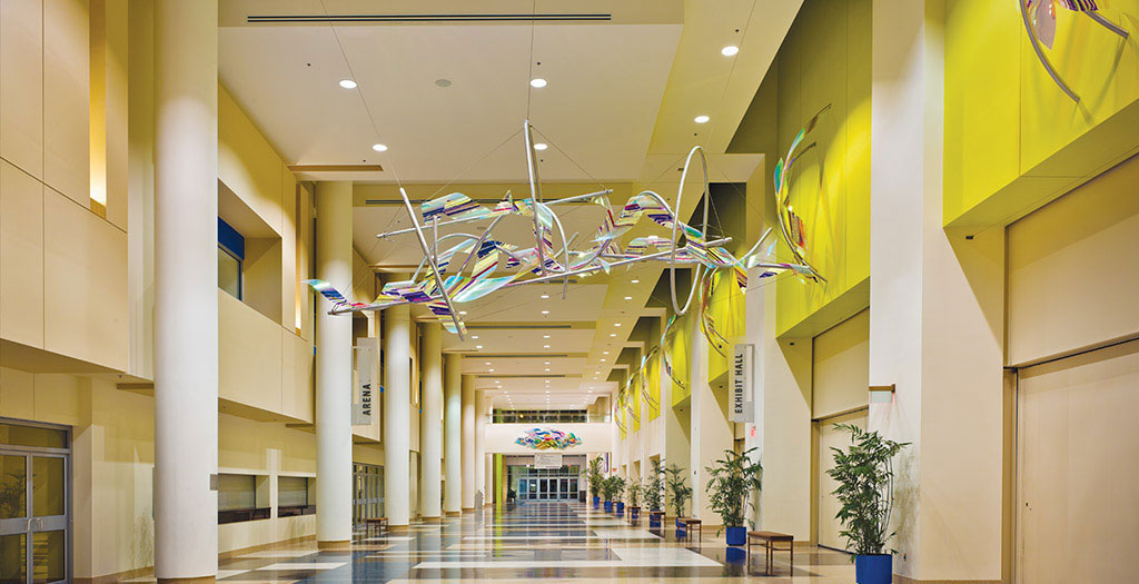 Entrance provides Floridian colors with artwork from area artists. Image